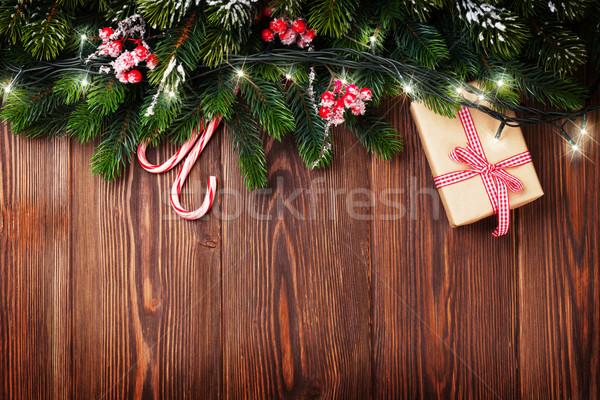Fir tree branch with christmas lights Stock photo © karandaev