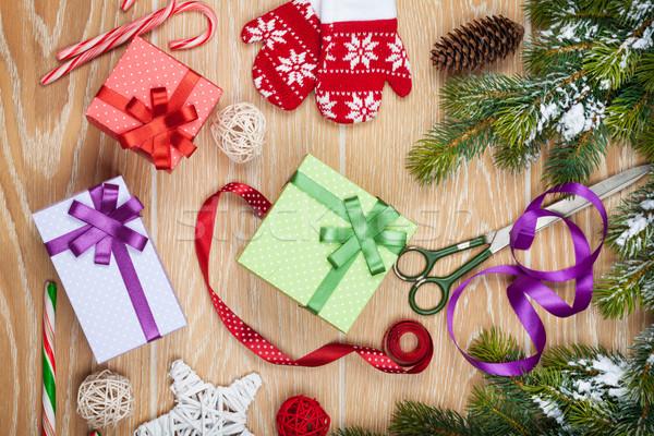 Christmas presents wrapping and snow fir tree Stock photo © karandaev