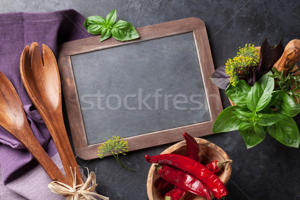Garden herbs in mortar, oil and chili Stock photo © karandaev