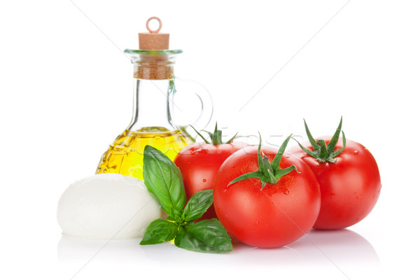 Mozzarella peynir zeytinyağı domates fesleğen ot Stok fotoğraf © karandaev