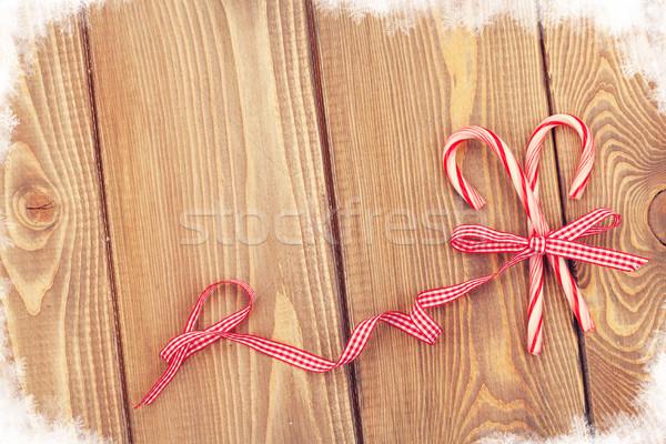 Snoep riet boeg christmas houten tafel Stockfoto © karandaev