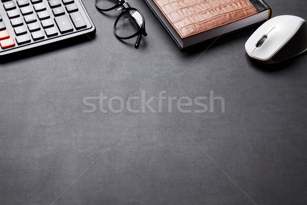 Office desk table with calculator, notebook and glasses Stock photo © karandaev