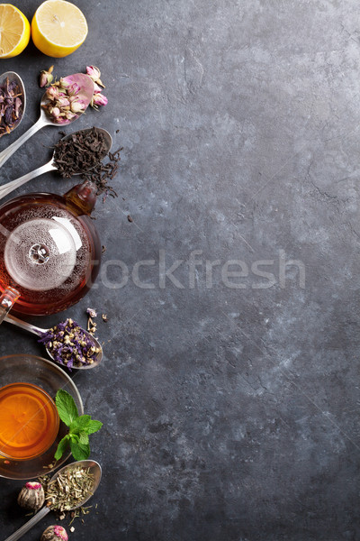 Stock photo: Tea cup, teapot and assortment of dry tea in spoons