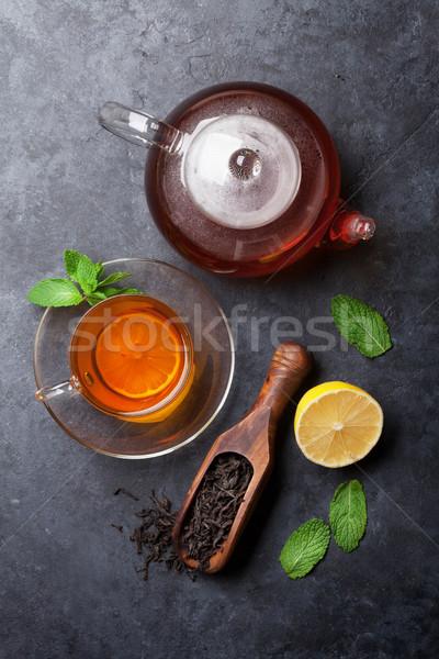 Tea cup, teapot and dry tea in spoon Stock photo © karandaev