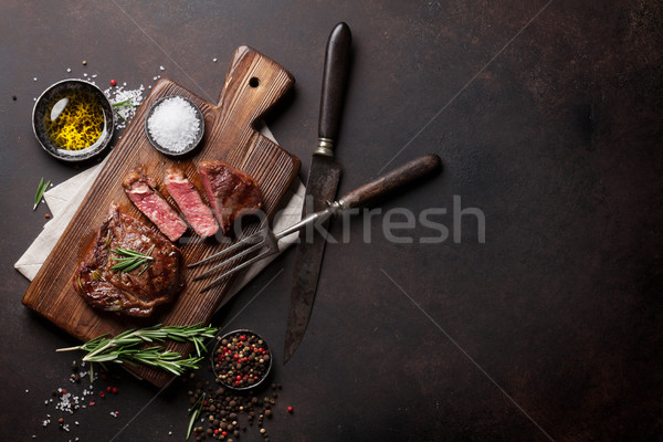 Grilled ribeye beef steak, herbs and spices Stock photo © karandaev