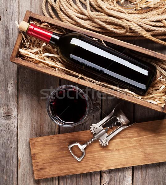 Red wine bottle and glass Stock photo © karandaev