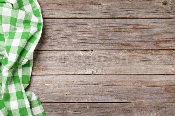 Kitchen towel on wooden table Stock photo © karandaev