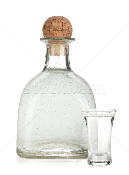 Bottle of silver tequila and shot with lime slice Stock photo © karandaev