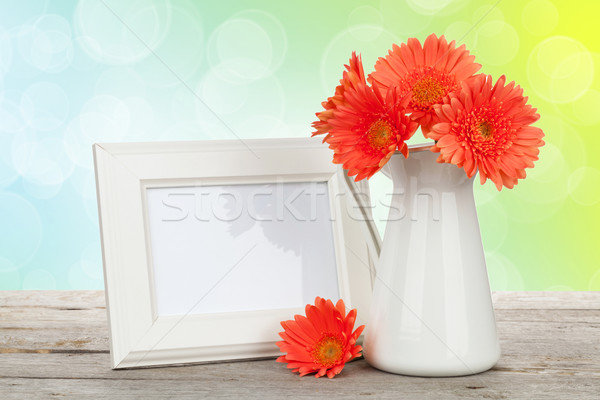 Orange gerbera flowers and photo frame Stock photo © karandaev