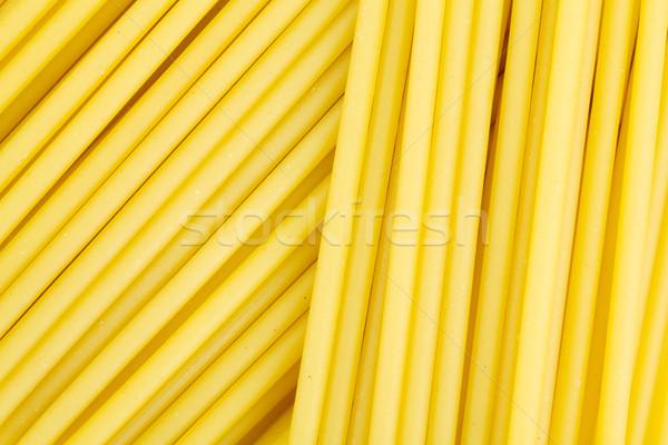 Spaghetti pasta primo piano sfondo colore giallo Foto d'archivio © karandaev