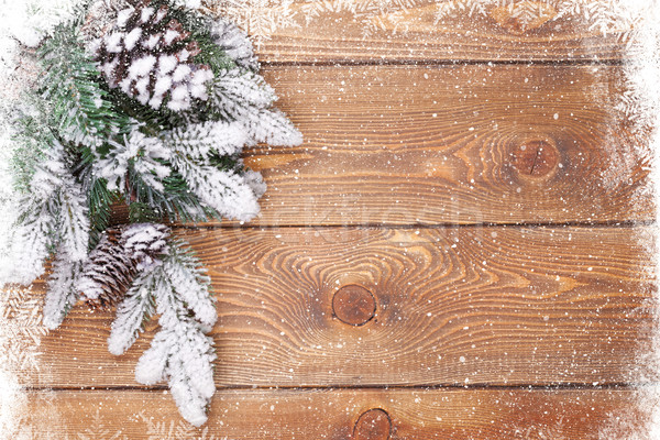 Old wood texture with snow and firtree Stock photo © karandaev