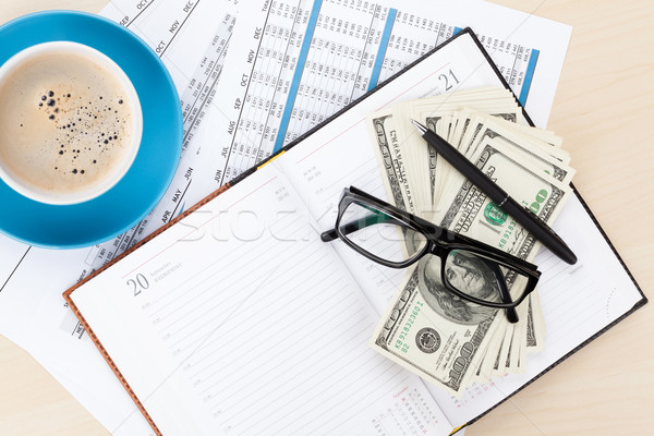 Office desk with reports, blank notepad and money cash Stock photo © karandaev