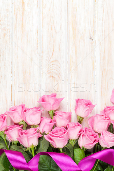 Stock photo: Pink roses bouquet over wooden table