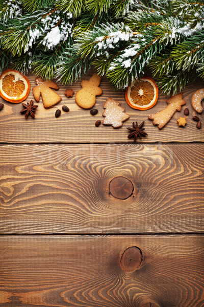 Christmas wooden background with snow fir tree, spices, gingerbr Stock photo © karandaev
