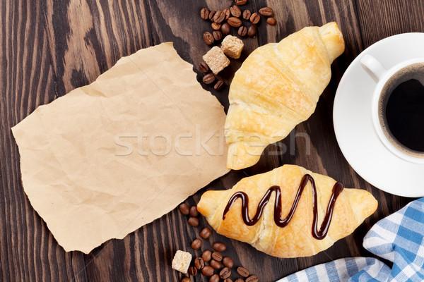 Friss croissantok kávéscsésze kávé fa asztal felső Stock fotó © karandaev