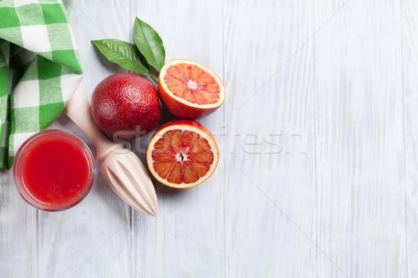 Fresh ripe red oranges and juice Stock photo © karandaev
