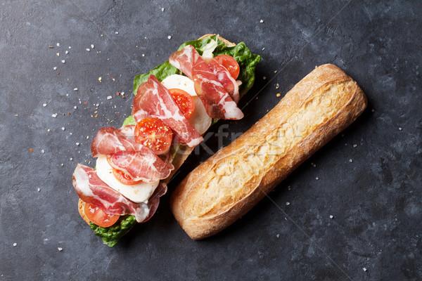 Szendvics saláta prosciutto mozzarella sajt kő Stock fotó © karandaev