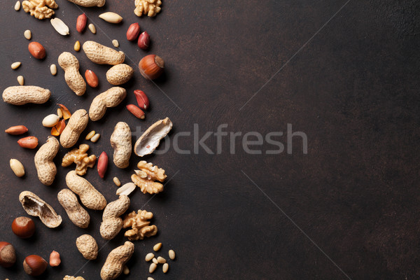 Különböző diók kő asztal felső kilátás Stock fotó © karandaev