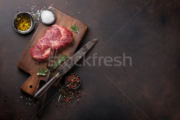 Raw ribeye beef steak cooking Stock photo © karandaev