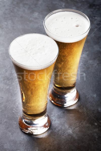 Piwo jasne pełne piwa okulary kamień tabeli bar Zdjęcia stock © karandaev
