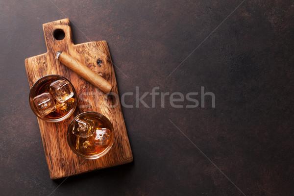 Whiskey with ice and cigar Stock photo © karandaev
