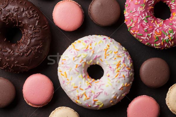 Colorful donuts and macaroons Stock photo © karandaev
