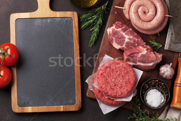 Crudo carne salchichas tocino superior vista Foto stock © karandaev