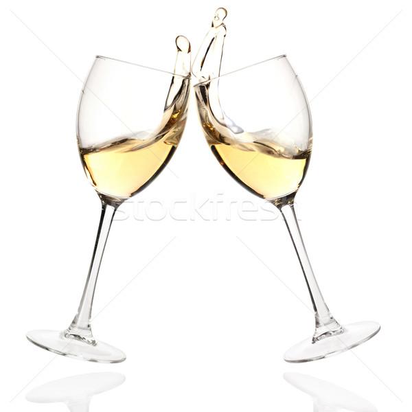 Clink glasses with white wine Stock photo © karandaev