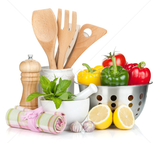 Fresh ripe vegetables, condiments and kitchen utensils Stock photo © karandaev