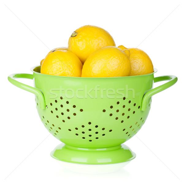 Fresh ripe lemons in colander Stock photo © karandaev