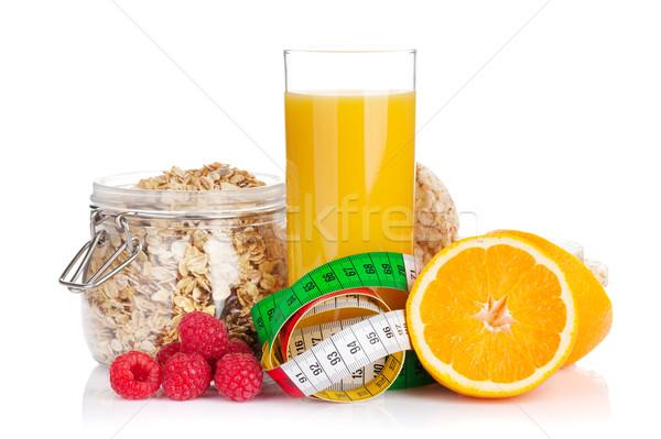 Colazione muesli frutti di bosco succo d'arancia isolato bianco Foto d'archivio © karandaev