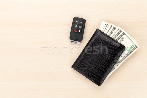 Money cash wallet and car remote key on wooden table Stock photo © karandaev