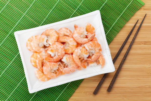 Cooked shrimps and chopsticks Stock photo © karandaev