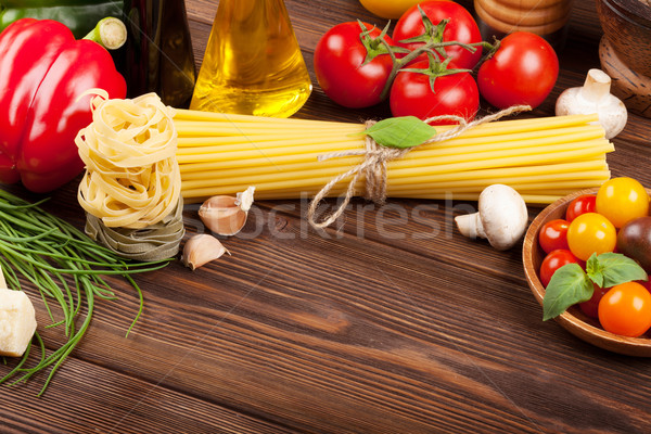 Italian food cooking ingredients. Pasta, tomatoes, basil Stock photo © karandaev