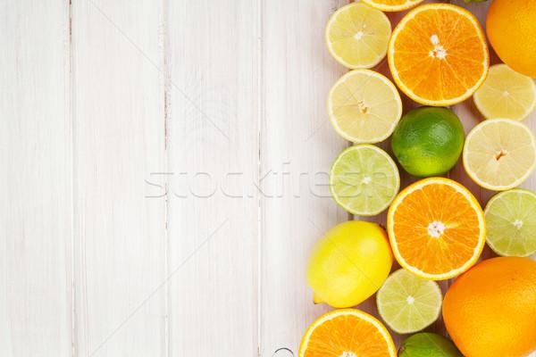 Citrus gyümölcsök narancsok citromok felső kilátás Stock fotó © karandaev