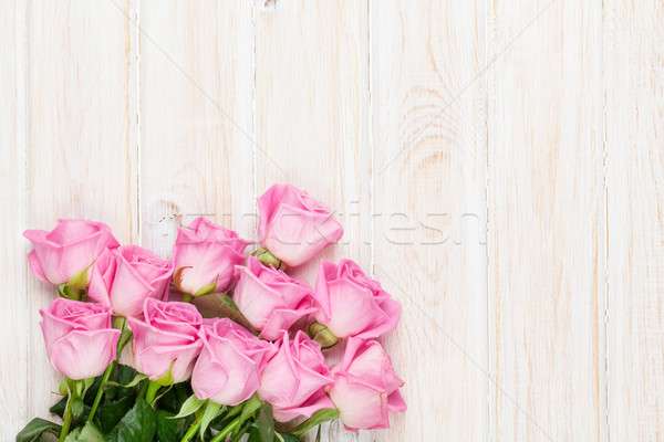 Pink roses bouquet over wooden table Stock photo © karandaev