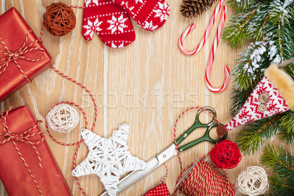 Christmas presents wrapping and snow fir tree over wooden table  Stock photo © karandaev