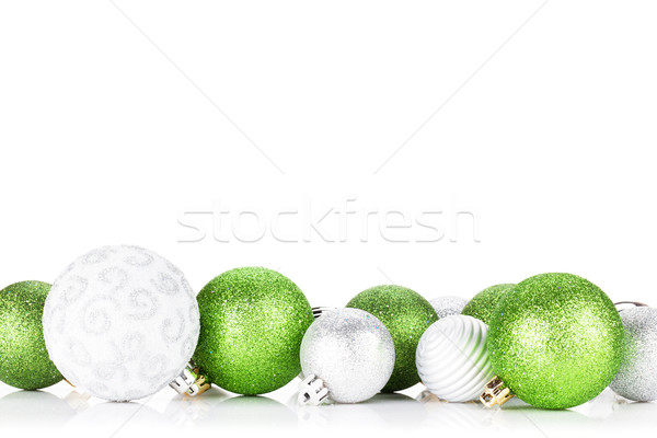 Green and silver christmas baubles Stock photo © karandaev