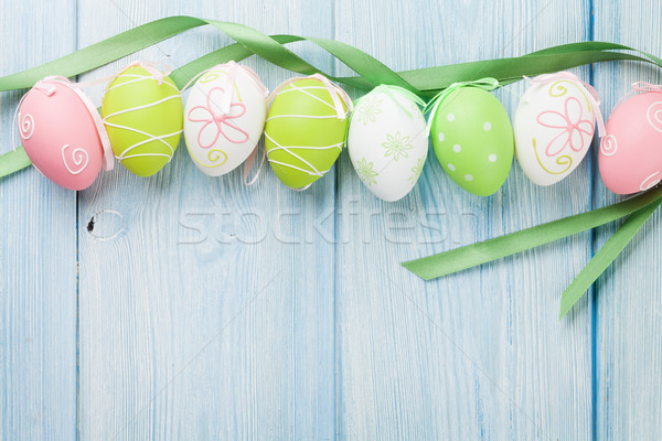 Paskalya renkli yumurta mavi ahşap masa üst Stok fotoğraf © karandaev