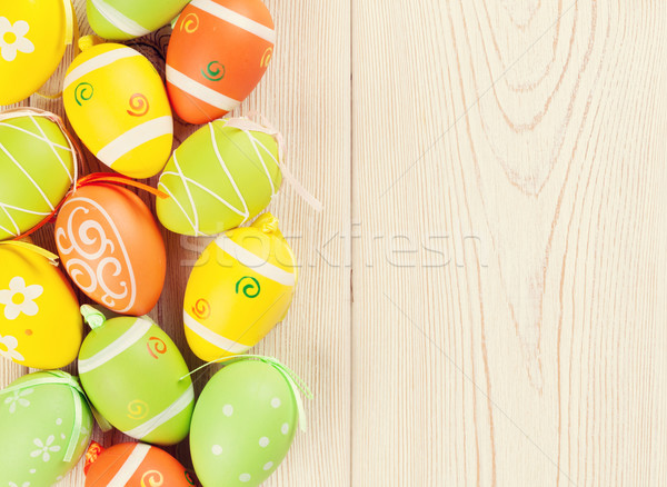 Pâques coloré oeufs table en bois haut vue Photo stock © karandaev