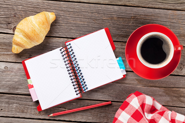 Fresh croissant, coffee and notepad Stock photo © karandaev