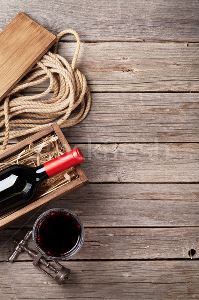 Stock photo: Red wine bottle and glass