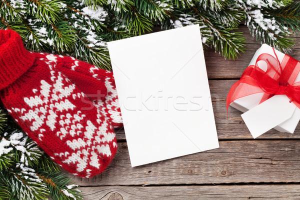 Noel tebrik kartı eldiveni hediye hediye kutusu Stok fotoğraf © karandaev