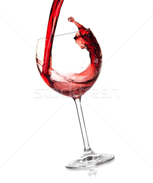 Stock photo: Wine collection - Red wine is poured into a glass