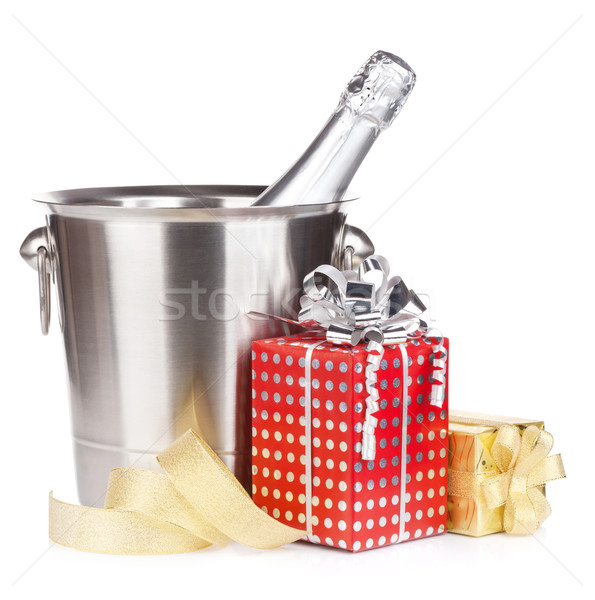 Champagne bottle in bucket and gift boxes Stock photo © karandaev
