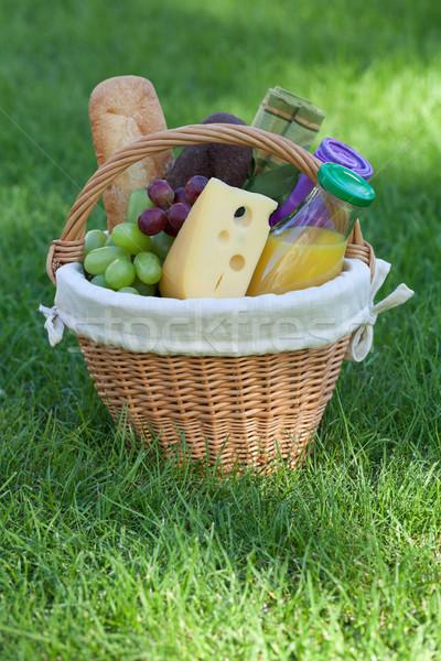 Açık piknik sepeti yeşil çim ekmek peynir Stok fotoğraf © karandaev