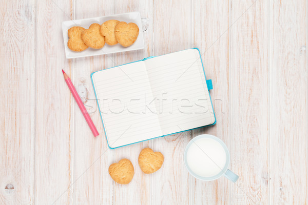 Cup of milk, heart shaped cookies and notepad Stock photo © karandaev