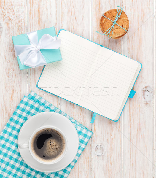 Cup of coffee, gingerbread cookies gift box and notepad Stock photo © karandaev