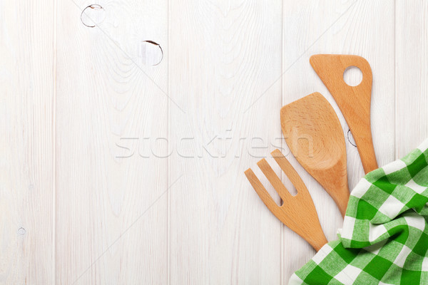 Kitchen utensils over white wooden table Stock photo © karandaev