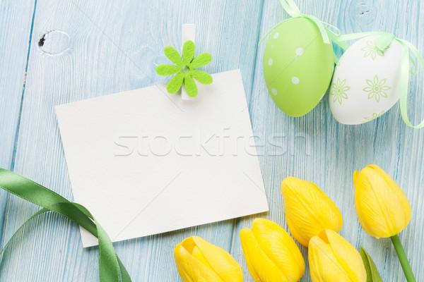 Húsvéti tojások tulipánok üres kártya üdvözlőlap kék fa asztal Stock fotó © karandaev